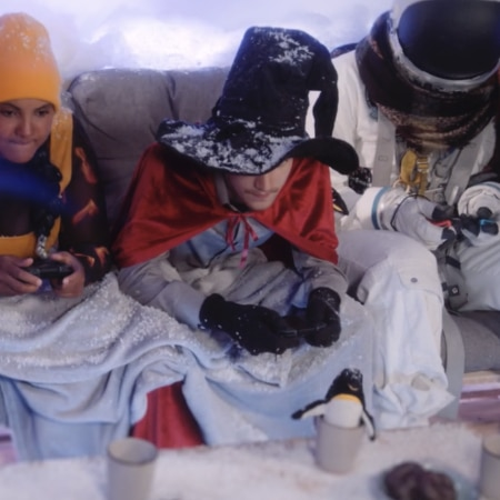 People playing on a snowed in couch